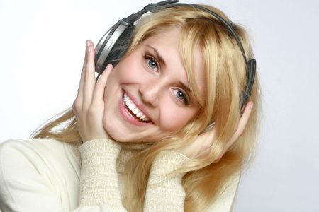Beautiful woman listening music in headphones. Stock Photo - 5625816