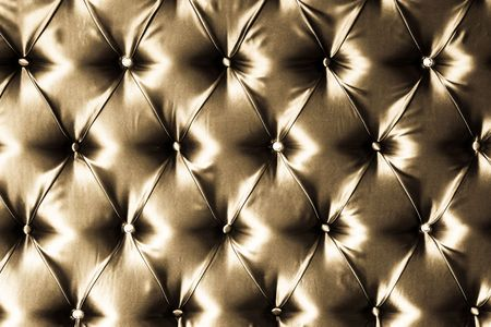 Sepia picture of genuine silk upholstery.