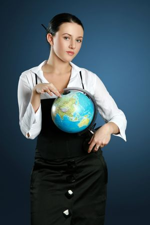 Close-up portrait of a gorgeous brunette with globe Stock Photo - 5634948