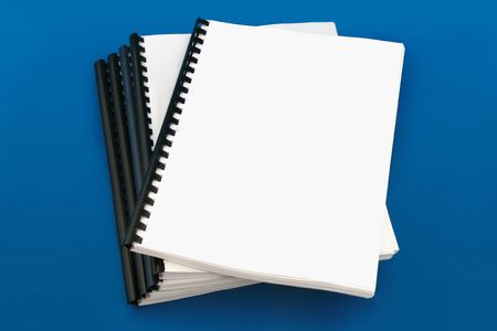 Spiral bound book, over blue background