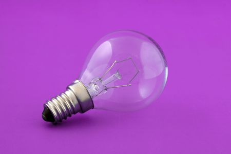Small electrical lamp over pink background Stock Photo - 5634978