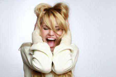 Young beautiful girl screaming, studio shot Stock Photo