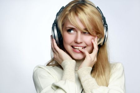 Beautiful girl listening music in headphones.