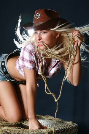 Beautiful rodeo girl in sheriff hat photo