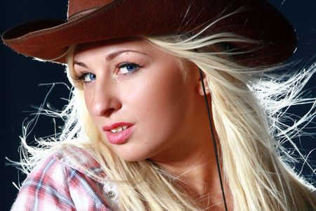 Close-up portrait of a beautiful sexy woman in cowboy hat photo