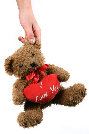 Teddy bear and big red heart, isolated on white background photo