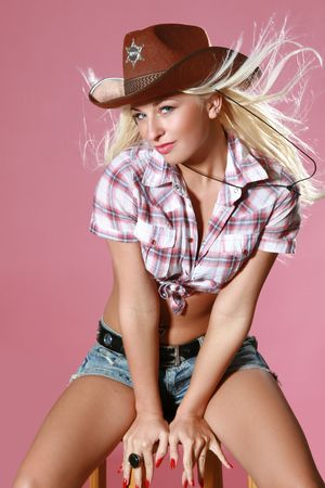 Close-up portrait of beautiful rodeo girl in sheriff hat