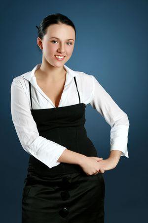Portrait of a gorgeous teacher over dark-blue background Stock Photo - 6374939