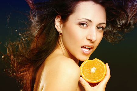 Beautiful woman with fresh orange photo
