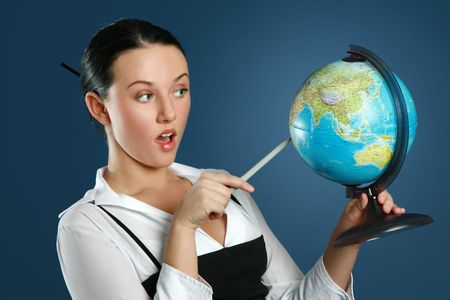 Close-up portrait of a gorgeous teacher with globe Stock Photo - 6375079