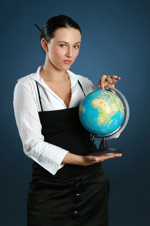 Close-up portrait. Young teacher shows the globe Stock Photo - 6382837