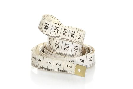 cintas metricas: Rizado blanco cinta de medici�n  Foto de archivo