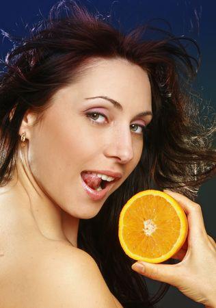 Pretty girl with fresh orange photo