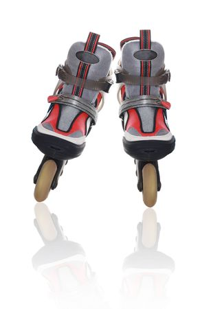 rollerskater: A pair of roller skates with reflection on a white background