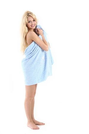 coquette: Beautiful blonde lady in a blue towel, isolated on white background Stock Photo