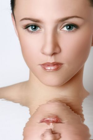 Close-up portrait of a sexy young girl with reflection