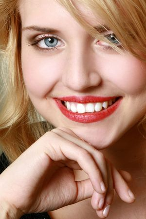 Attractive young woman face with great smile. Close-up. Stock Photo - 6461570