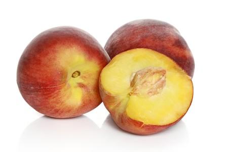 Juicy nectarines on a white background Stock Photo