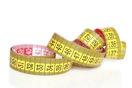 unwound: Measure tape on white background Stock Photo
