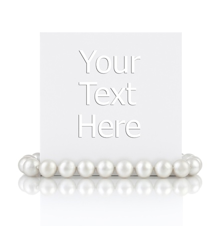 Pearls with empty gift card on a white background