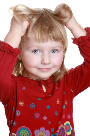 Close-up portrait of a happy little girl photo