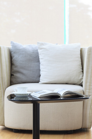 Sofa seat with pillows book and coffee Home Interior decoration Stock Photo
