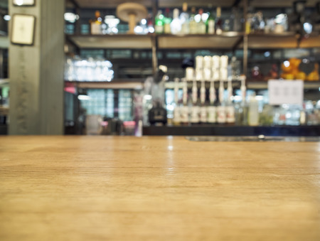 counter top: Top of wood table with bar background