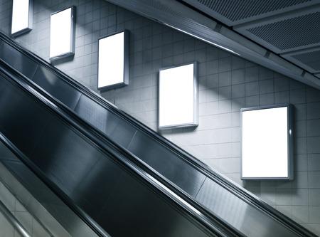 Mock up poster ads at escalator side in Subway station