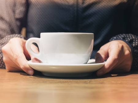 mocked: Woman holding Coffee cup mock up