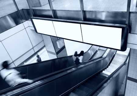 Blank Banner Billboard Display with escalator and people in subway station Stock Photo