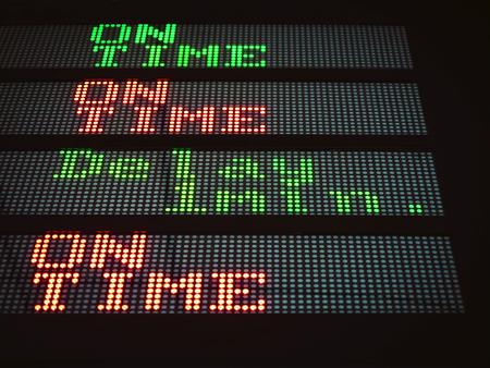 delay: Sign informing at airport subway transportation; Signage alert passengers of a delay