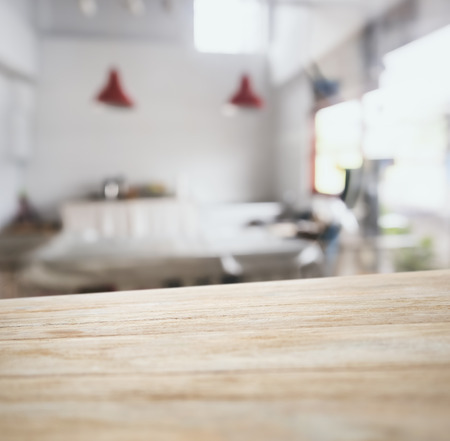 blurry: Table top counter bar with blurred kitchen background Stock Photo