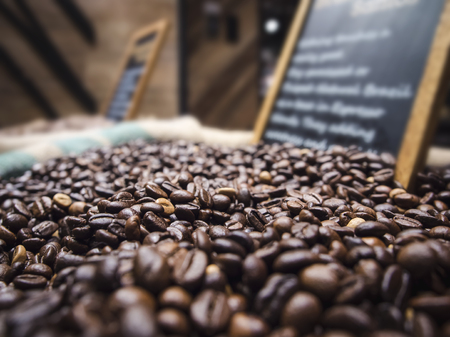 mocked: Coffee beans for sell with black board sign in retail store Stock Photo