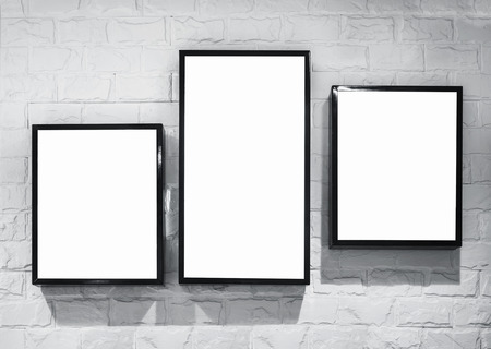 wall light: Mock up Light box frame deisgn template on white brick wall Stock Photo