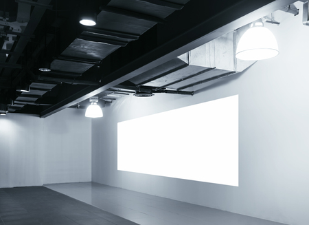 mocked: Mock up blank Screen display on wall Exhibition in perspective