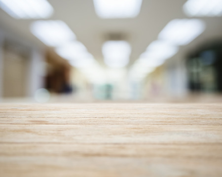 Table top with Blurred Office space Interior Background Foto de archivo
