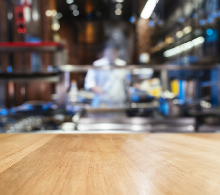 kitchen counter top: Table top counter blur Kitchen and Chef cooking background Stock Photo