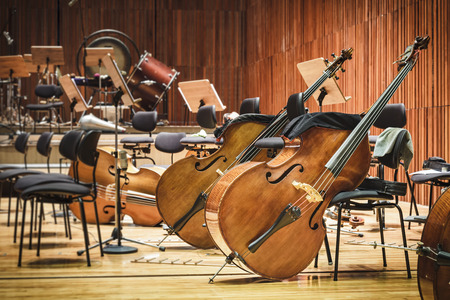 auditorium: Cello Music instruments on a stage