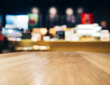 wooden surface: Table top Counter with Blurred Cafe Bar interior background Stock Photo
