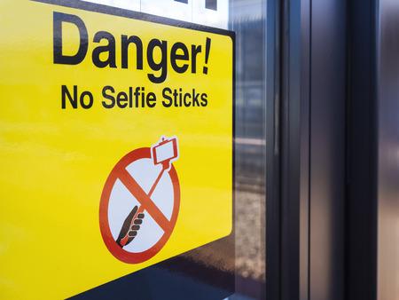 disallow: Selfie forbidden Signage warning in Public transportation area