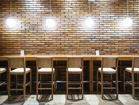 Table Counter Bar With Chairs And Lights Brick Wall Background .