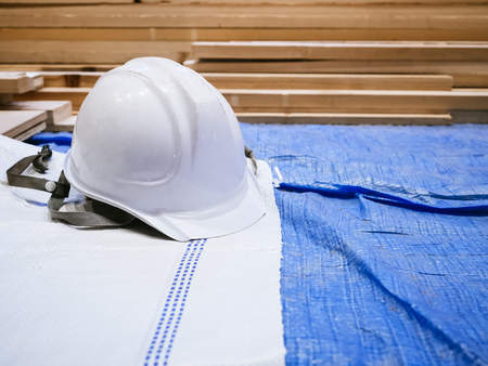 white hat: Safety helmet in Construction site Industrial concept Stock Photo