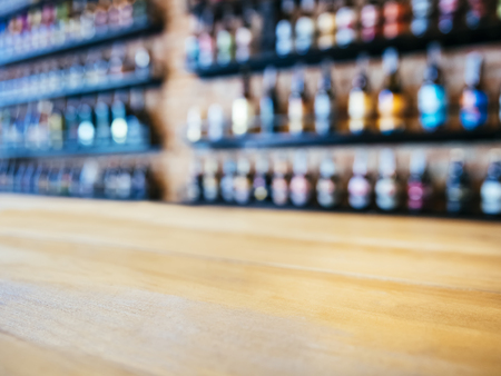 liquor: Table top Counter with Blurred Wine Liquor bottles Display Background