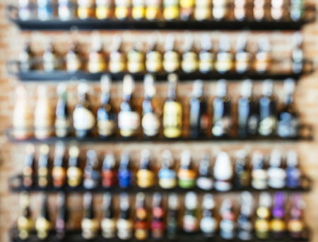Blurred Wine Liquor bottles Display on shelf in Bar restaurant