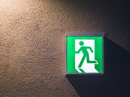 light box: Fire Exit Sign Light box on wall with lighting Building Safety signage Stock Photo