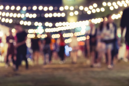 summer night: Festival Event Party with People Blurred Background