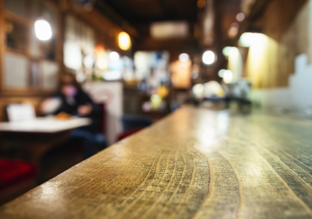 mocked: Table top counter Bar restaurant background with Blurred people
