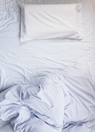 bed sheet: White unmade Bed mattress Duvet with pillow and blanket Top view Stock Photo