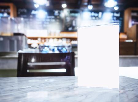 promotion: Mock up Menu frame on Table in Bar restaurant cafe background Stock Photo