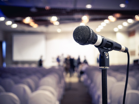 Microphone in Conference Seminar room Business Meeting Event Background Stock Photo